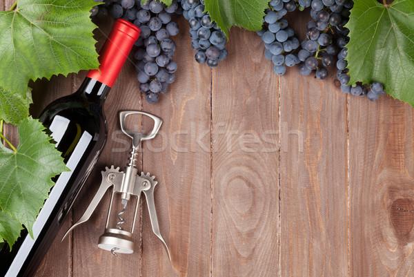 красный винограда бутылку вина штопор деревянный стол Top Сток-фото © karandaev