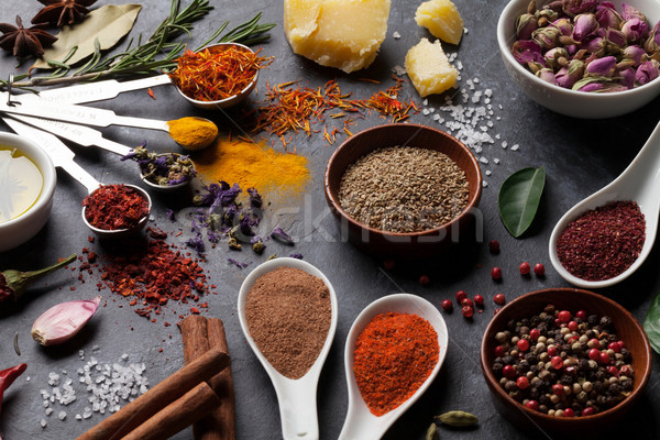 Herbs and spices over black stone Stock photo © karandaev