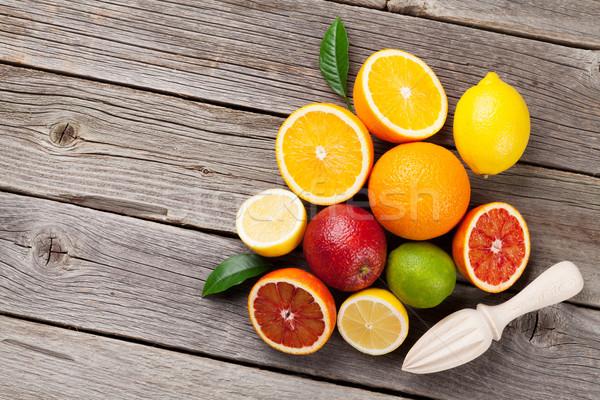 Citrus fruits on wooden table Stock photo © karandaev