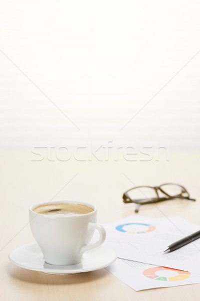 Stock photo: Office workplace with coffee, supplies and reports