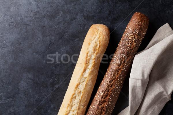 Mixed breads on stone table Stock photo © karandaev