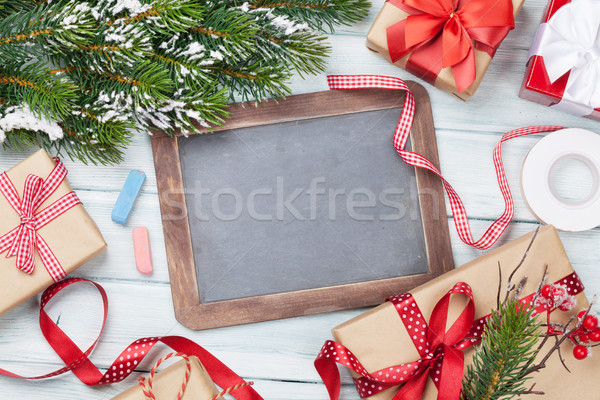 Christmas chalkboard, gifts, decor and fir tree Stock photo © karandaev