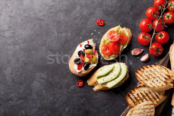 Tost sandviçler avokado domates zeytin taş Stok fotoğraf © karandaev