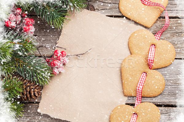 Christmas fir tree and heart gingerbread cookies Stock photo © karandaev