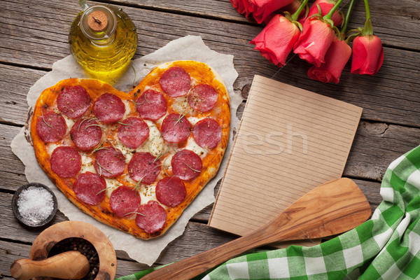Heart shaped pizza Stock photo © karandaev