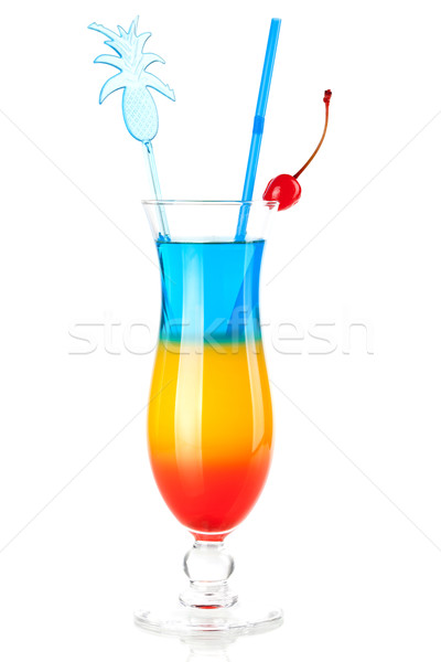 Layered tropical cocktail with pineapple decoration Stock photo © karandaev