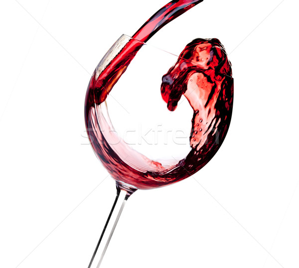 Wine collection - Red wine is poured into a glass Stock photo © karandaev
