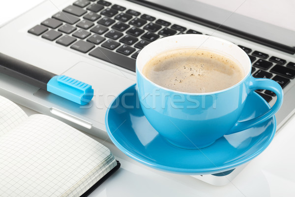 Blue coffee cup, laptop and office supplies Stock photo © karandaev