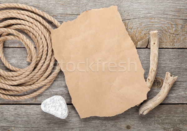 Old paper and rope on wooden textured background Stock photo © karandaev