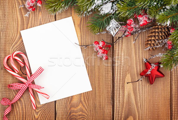 Christmas greeting card or photo frame over wooden table with sn Stock photo © karandaev