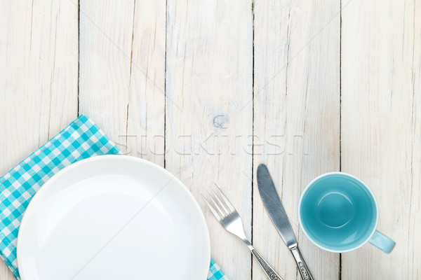 Empty plate, cup and silverware Stock photo © karandaev