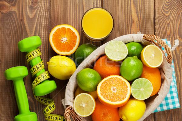 Citrus fruits in basket and dumbells. Oranges, limes and lemons Stock photo © karandaev