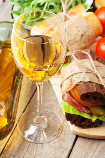 White wine glass, sandwiches and salad Stock photo © karandaev