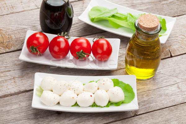 Tomates mozzarella verde ensalada hojas Foto stock © karandaev
