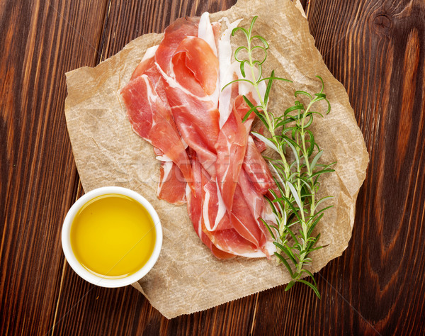 Prosciutto with rosemary and olive oil Stock photo © karandaev