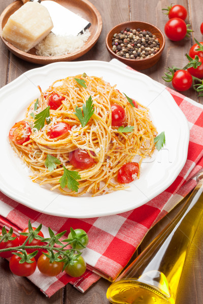 Spaghetti pasta with tomatoes and parsley Stock photo © karandaev