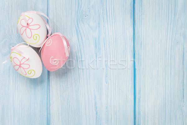 Easter eggs on wooden table Stock photo © karandaev
