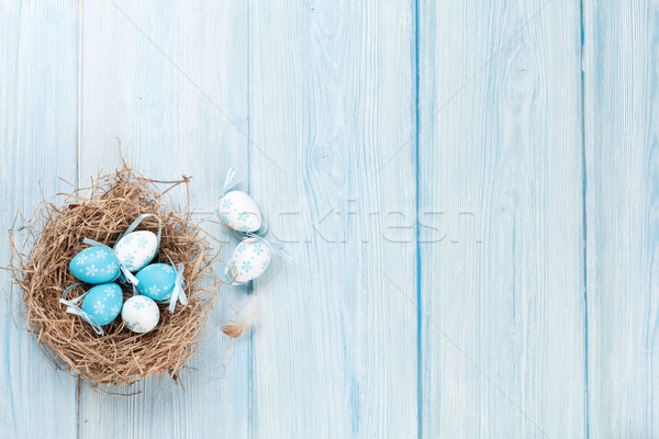 Easter eggs nido legno top view copia spazio Foto d'archivio © karandaev