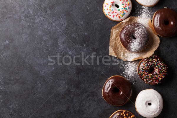 Kleurrijk donuts steen tabel top Stockfoto © karandaev
