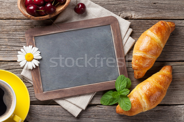 Blackboard, croissants and coffee Stock photo © karandaev