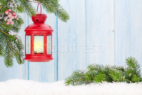 Christmas candle lantern on fir tree branch in snow Stock photo © karandaev