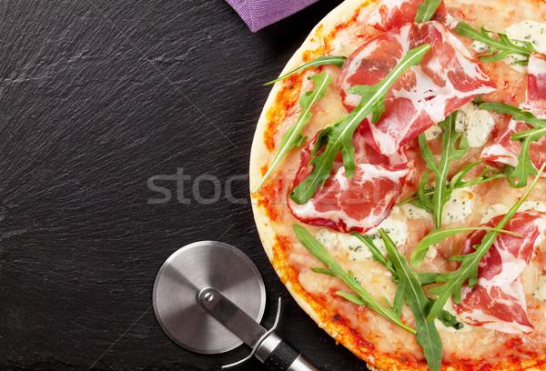 Pizza prosciutto mozzarella taş tablo üst Stok fotoğraf © karandaev