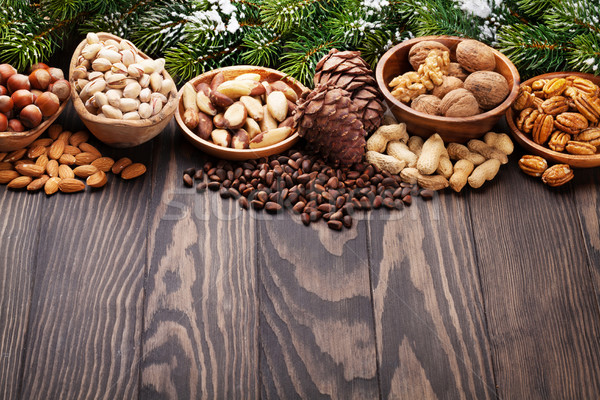 Stock photo: Various nuts on wooden table