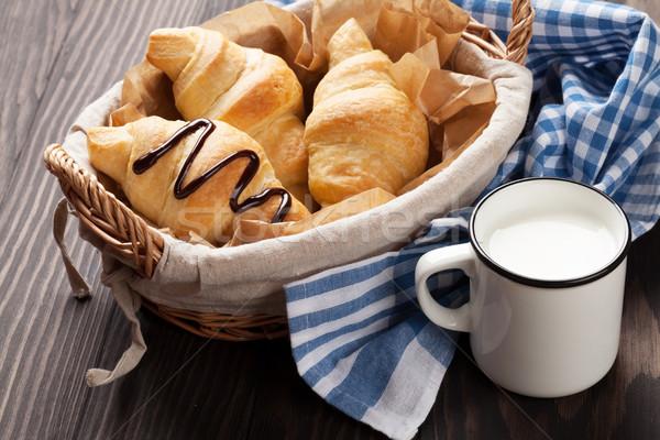 Friss croissantok kosár tej fa asztal papír Stock fotó © karandaev