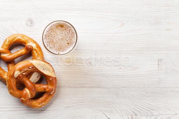Alman birası bira tuzlu kraker ahşap masa üst görmek Stok fotoğraf © karandaev