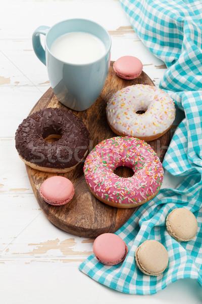 Milk, macaroons and donuts Stock photo © karandaev
