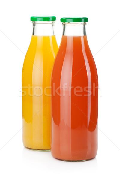 Narancs grapefruit dzsúz üvegek izolált fehér Stock fotó © karandaev