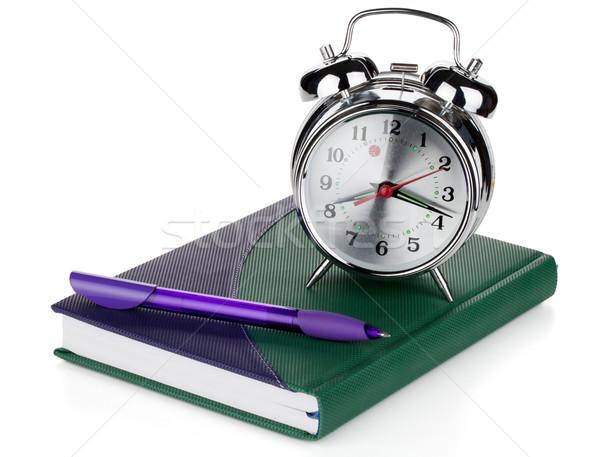 Alarm clock and pen on notepad Stock photo © karandaev