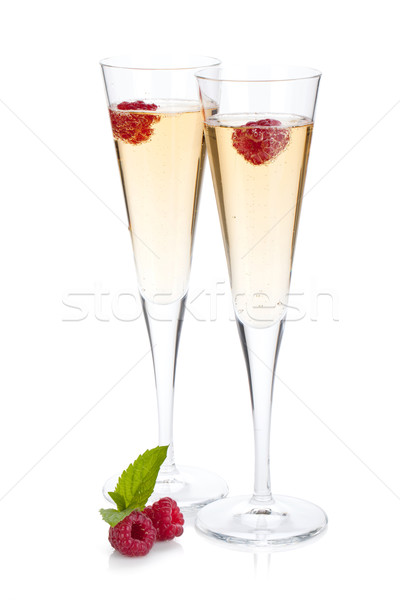 Champagne with raspberry Stock photo © karandaev