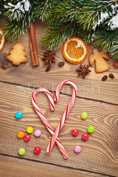 Christmas background with snow fir tree, spices and gingerbread  Stock photo © karandaev