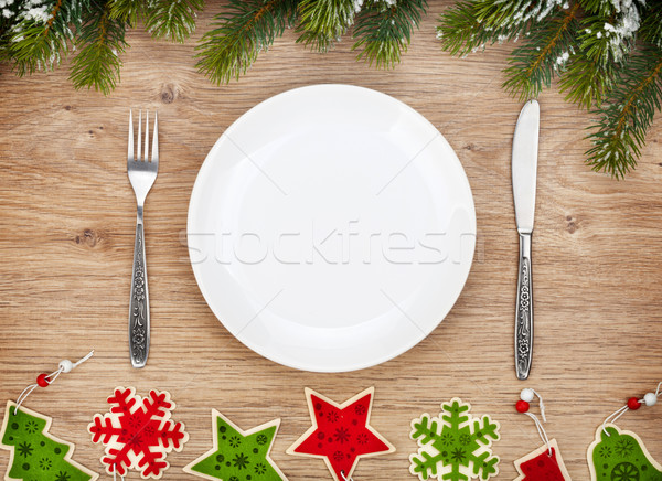 Empty plate with silverware, fir tree and christmas decor Stock photo © karandaev