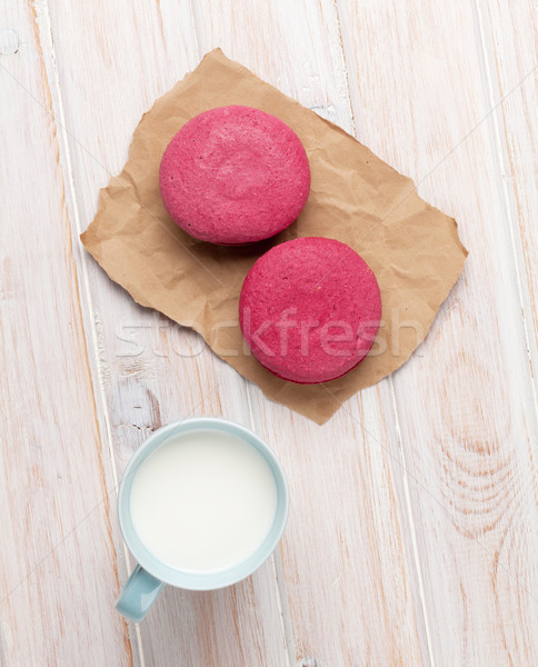 Colorful macarons and cup of milk Stock photo © karandaev