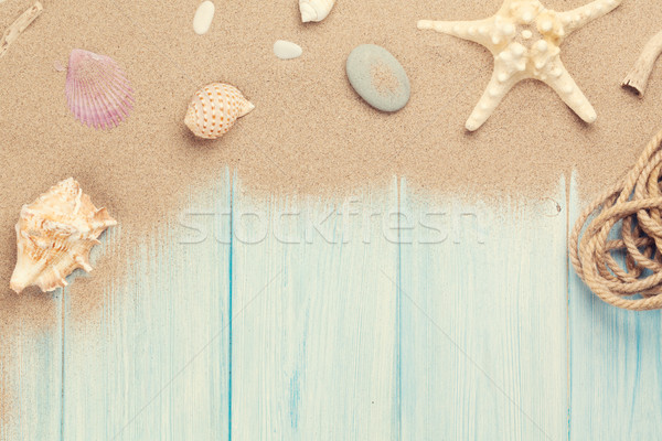Mer sable starfish obus table en bois haut Photo stock © karandaev