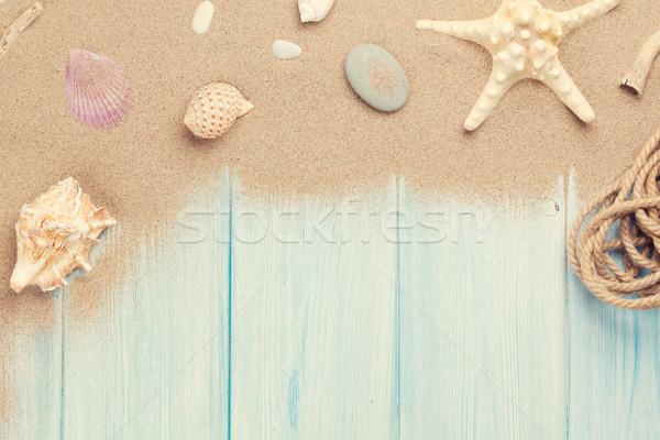 морем песок Starfish снарядов деревянный стол Top Сток-фото © karandaev