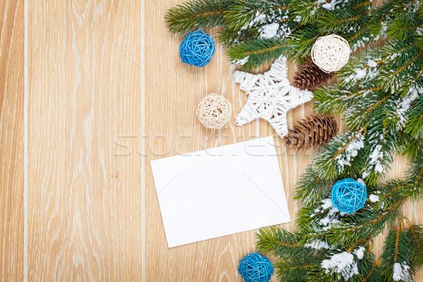 Natale biglietto d'auguri photo frame tavolo in legno neve Foto d'archivio © karandaev