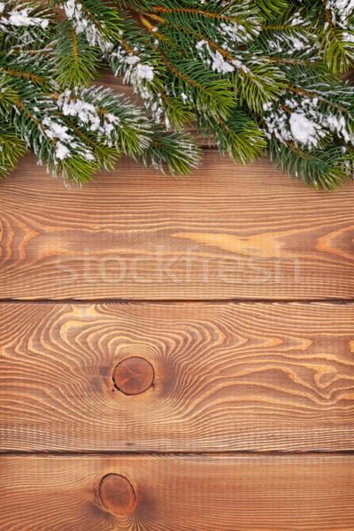 Christmas fir tree with snow on rustic wooden board Stock photo © karandaev