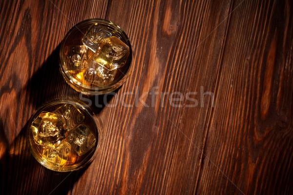 Szemüveg whiskey jég fa fa asztal felső Stock fotó © karandaev