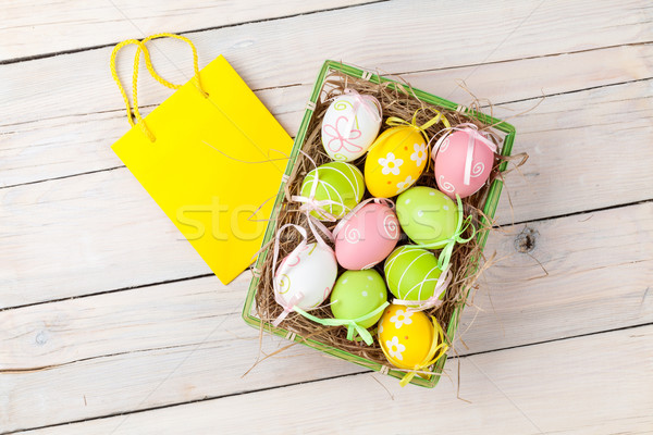 Easter background with colorful eggs and gift bag Stock photo © karandaev