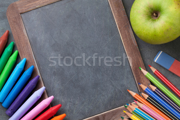 Chalk board and school supplies Stock photo © karandaev