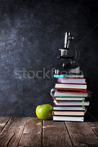 Notepads, microscope and apple in front of chalk board Stock photo © karandaev