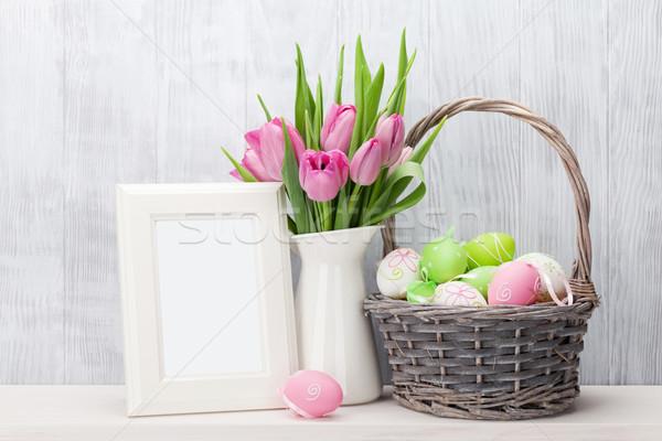 Easter eggs, photo frame and pink tulips Stock photo © karandaev