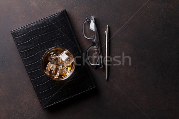 Whiskey with ice and business office supplies Stock photo © karandaev