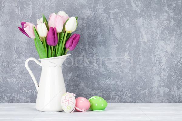Easter eggs colorato tulipani bouquet muro di pietra spazio Foto d'archivio © karandaev