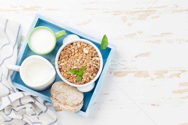 Sağlıklı kahvaltı ayarlamak müsli süt üst Stok fotoğraf © karandaev