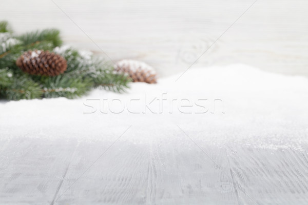 Christmas table backdrop with fir tree covered by snow Stock photo © karandaev