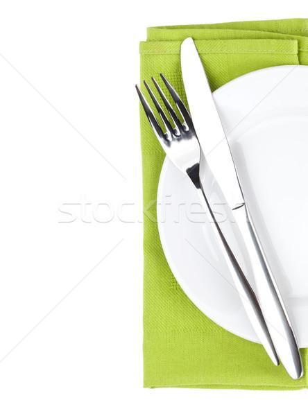 Silverware or flatware set of fork and knife over plate Stock photo © karandaev